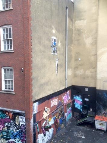 Banksy, man hanging