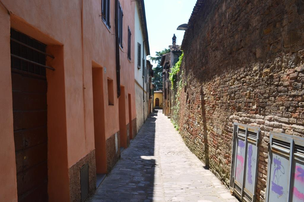 Doors and door at the end of the street, Citta di Castello, Umbria, Italy