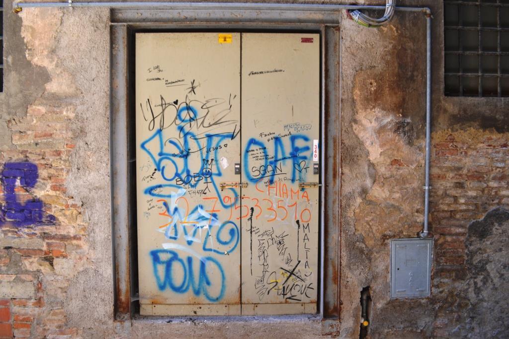 Graffiti and tags door, Citta di Castello, Umbria, Italy