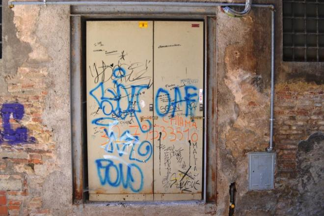 Graffiti and tags door, Citta di Castello, Umbria, Italy