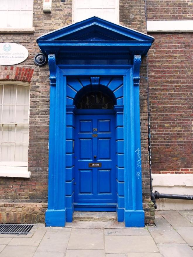 Blue door and fine portico, Fournier Street, London, April 2019