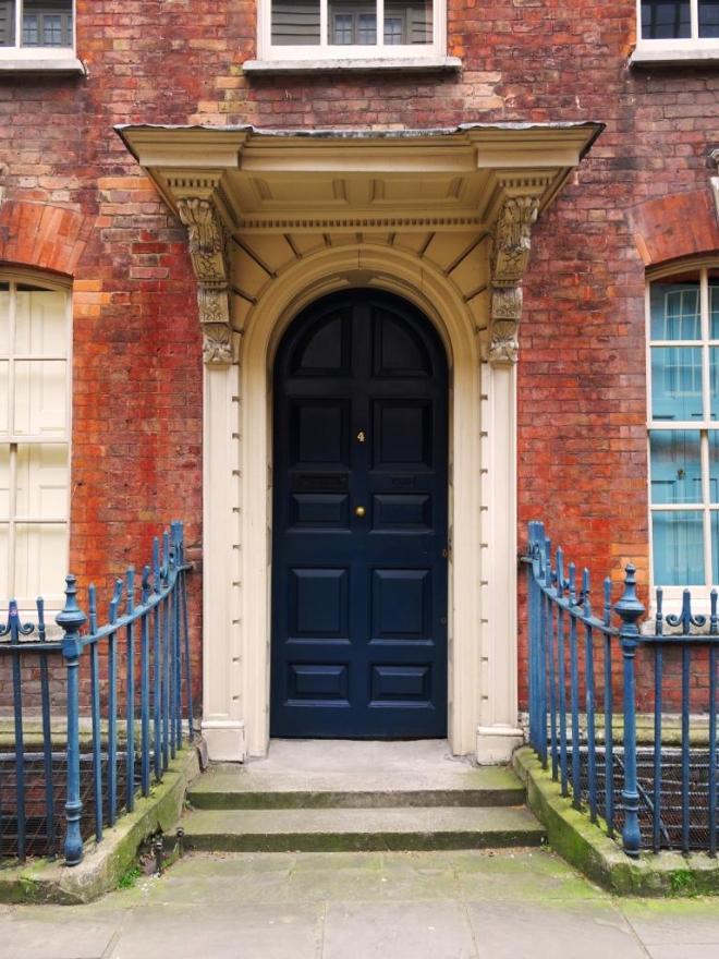 Door with splendid portico, Fournier Street, London, April 2019
