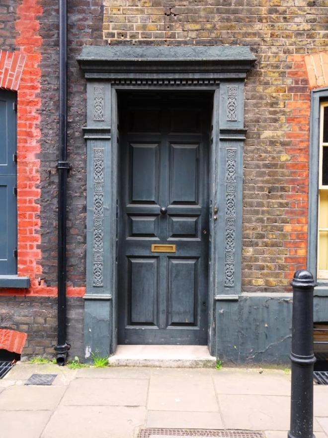 Door with beautiful surround, Fournier Street, London, April 2019