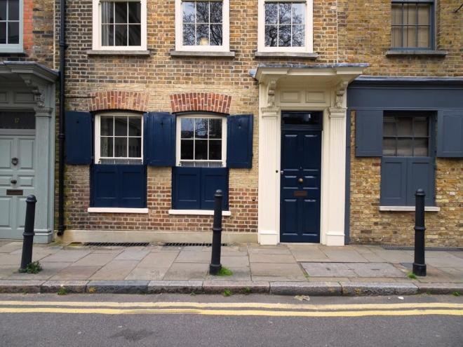 Dark blue door and matching shutters, Fournier Street, London, April 2019