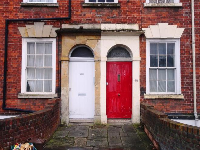 Red and white door (the colours of Bristol City football club), Hotwells, Bristol, March 2019
