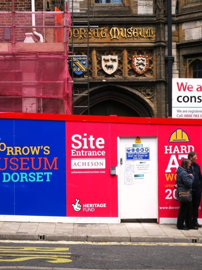 Dorset museum. Shame about the hoarding and door in front of the door. Dorchester, June 2019
