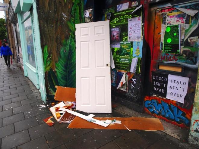 Is this the same abandoned door? and can you see the door behind all the posters? Stokes Croft, Bristol, June 2019
