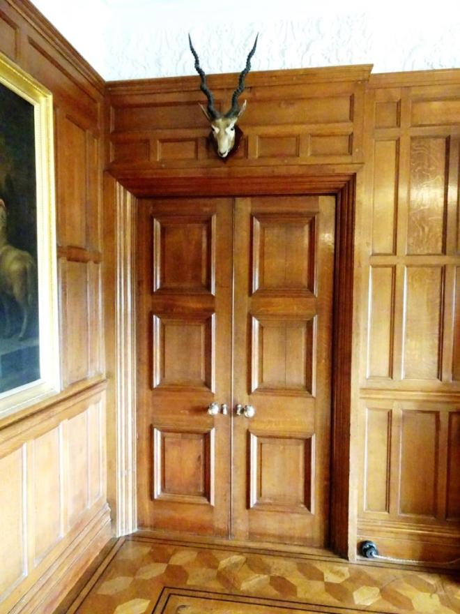 Doors and trophy, Lanhydrock House, Cornwall, August 2019