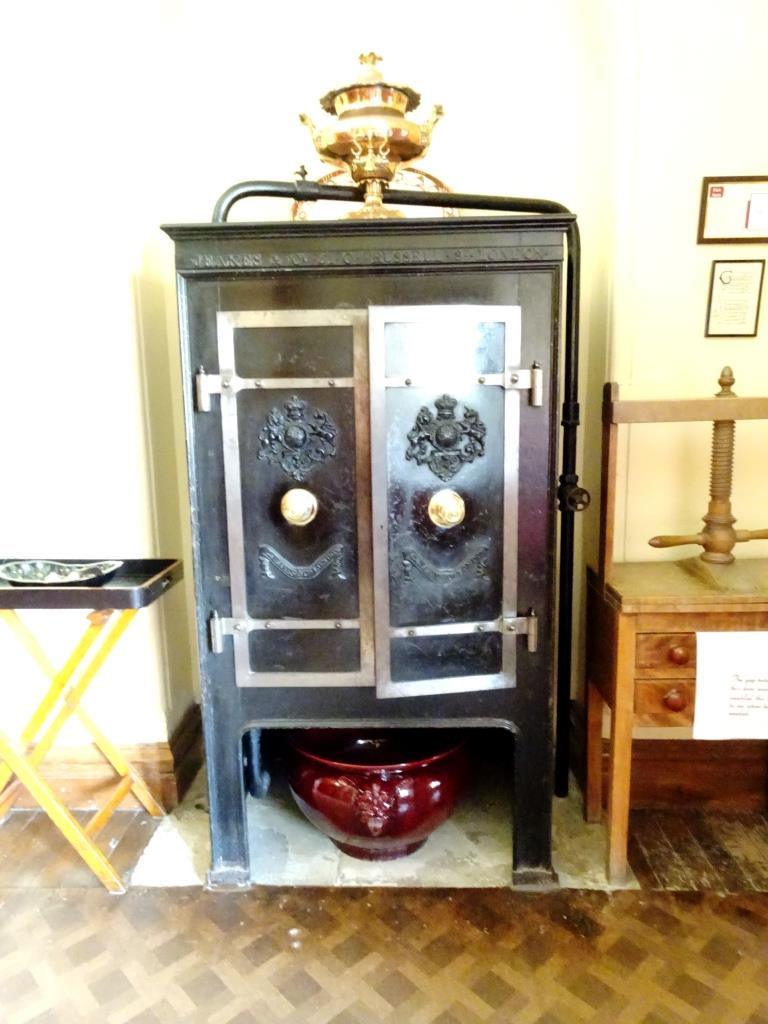 This cast iron cabinet kept the food warm between the kitchens and dining room, Lanhydrock House, Cornwall, August 2019