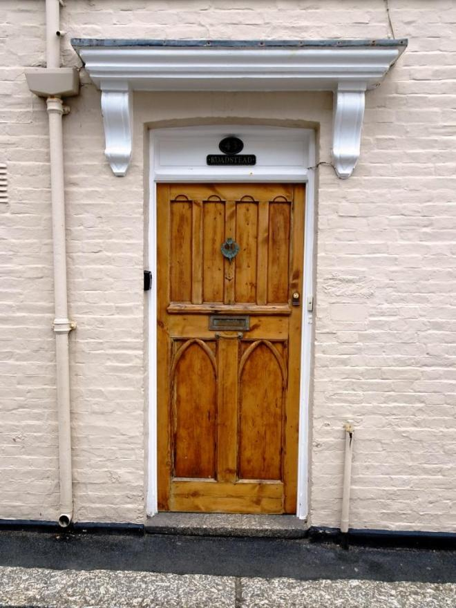 Varnished wood door, Fowey, Cornwall, September 2019