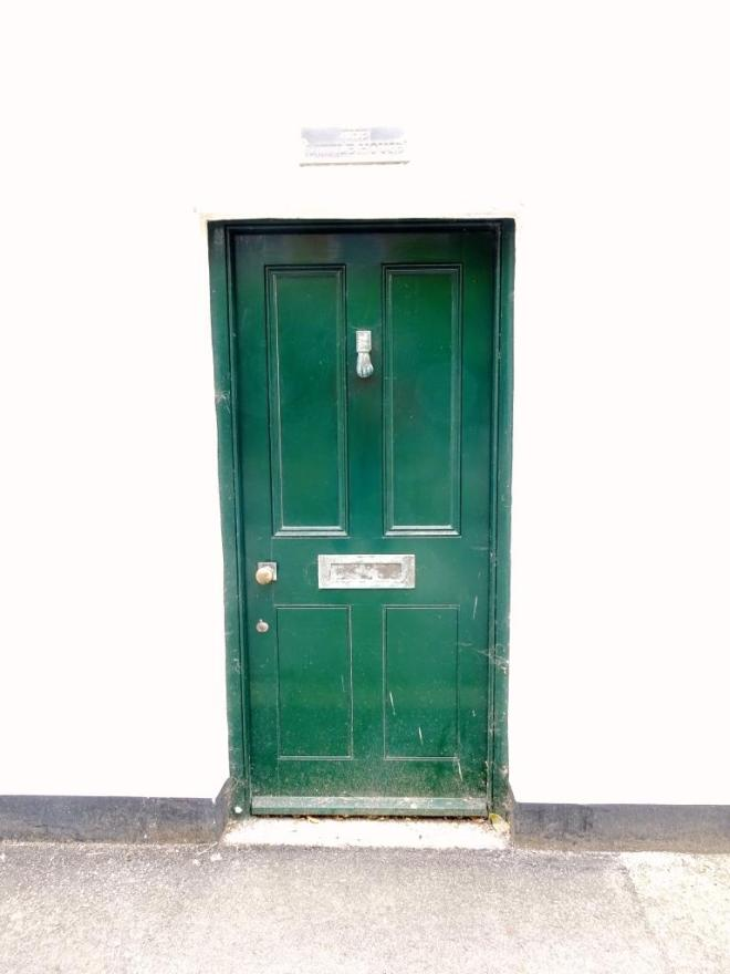 Low green door, Fowey, Cornwall, September 2019