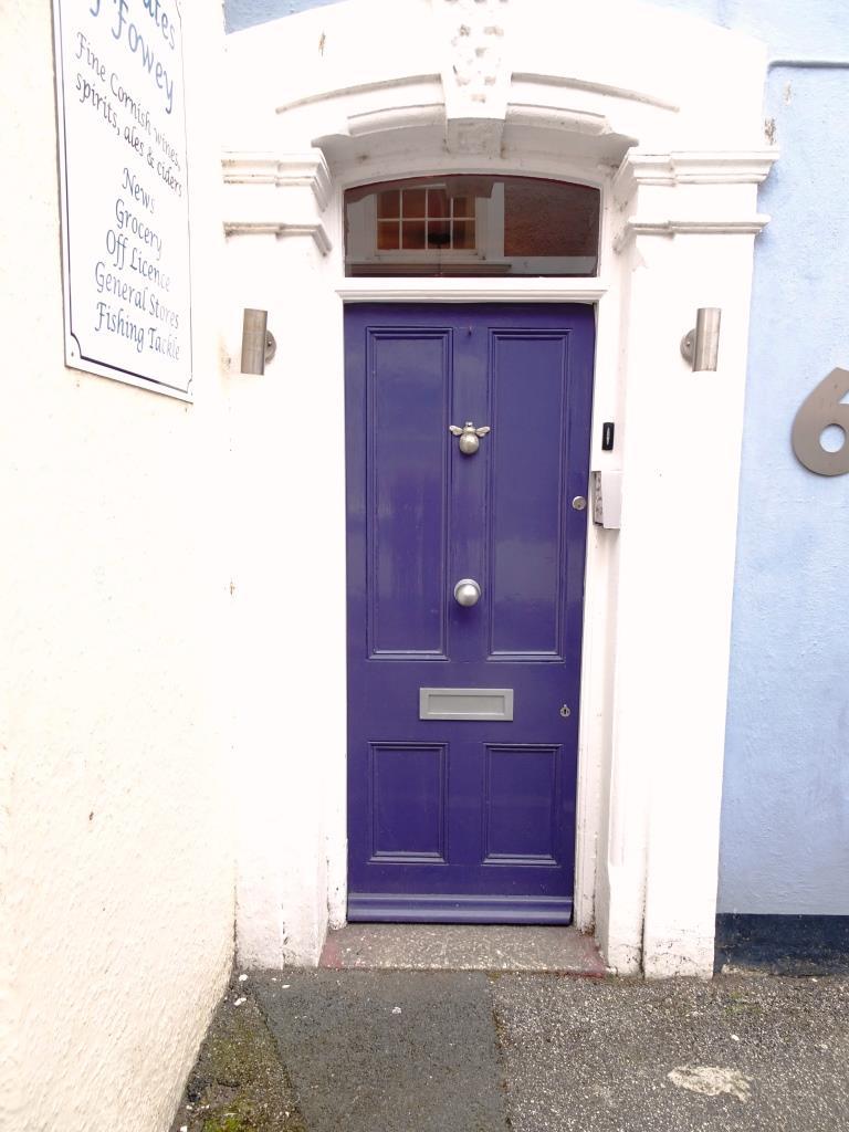 Blue door with bee knocker, Fowey, Cornwall, September 2019
