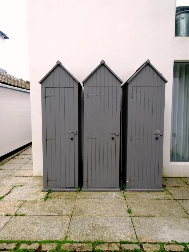 Three locker doors in a 'beach hut' style, Fowey, Cornwall, September 2019