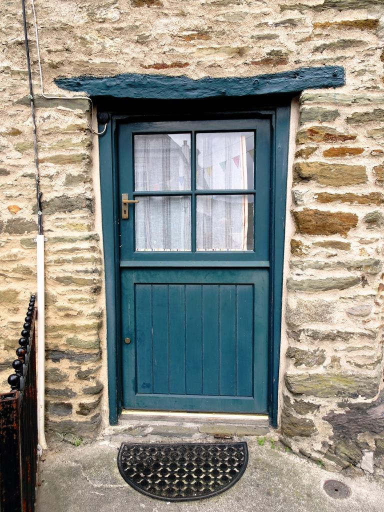 Beautiful old lintle over a stable style door, Fowey, Cornwall, September 2019
