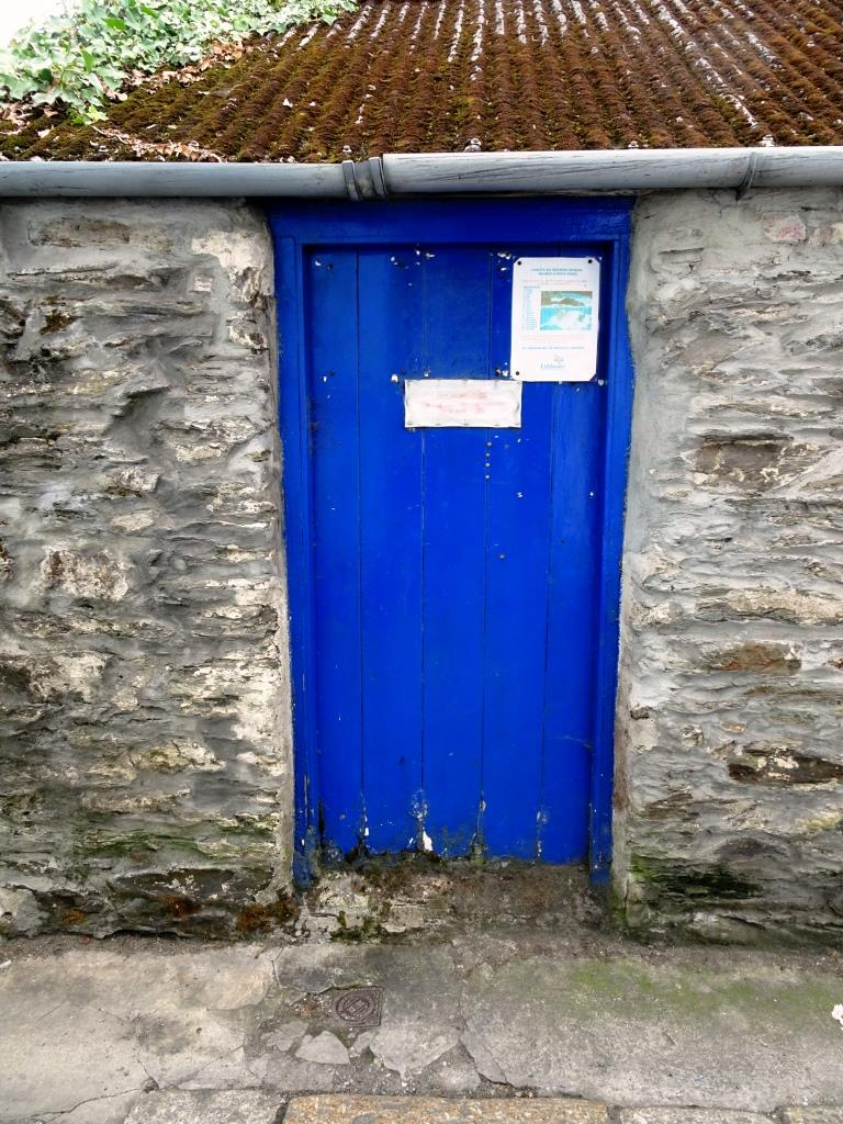 Fine blue gate (no handle?), somewhat weathered at the base, Fowey, Cornwall, September 2019