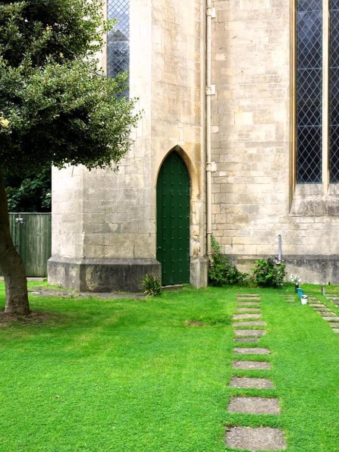 Manicured lawn and green door, Cheltenham, September 2019