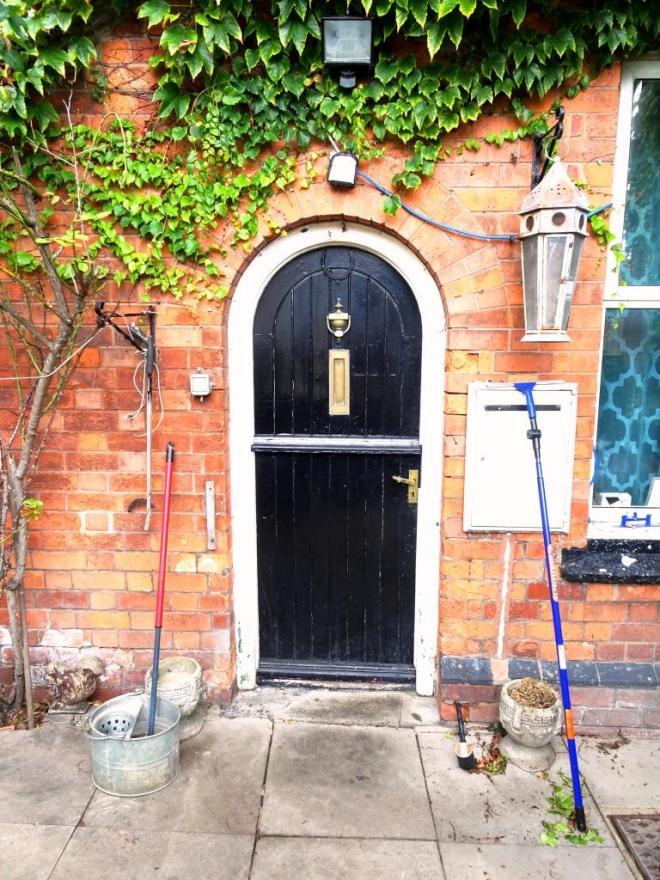 Looks like chores day for the occupants behind this black split door, Cheltenham, September 2019