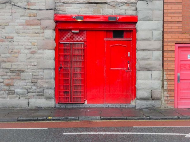 Two red doors, the Harbourside, Bristol, November 2019