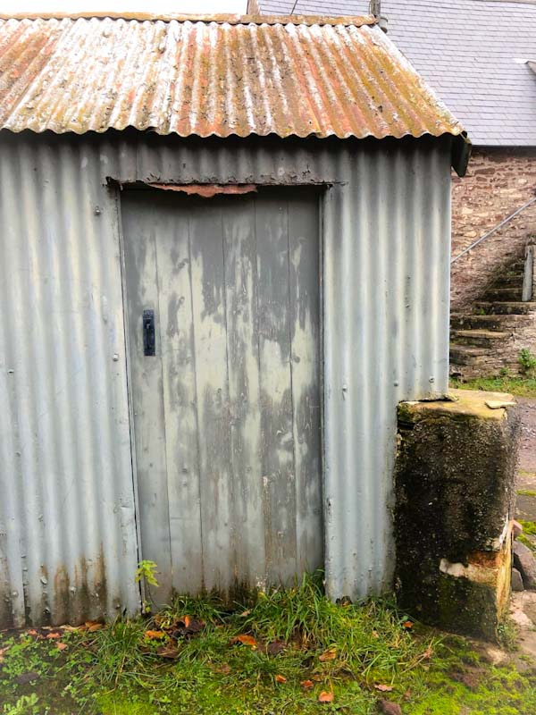 Abandoned farm house out building door, Llangorse Lake, Wales, December 2019