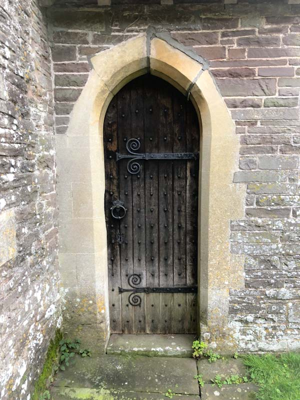 Side door, St Gastyn's Church, Llangorse Lake, Wales, December 2019