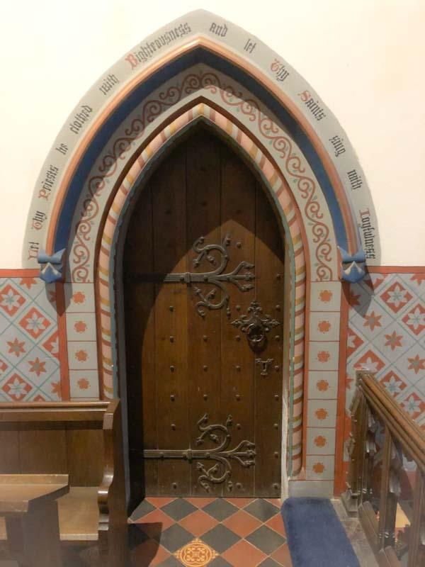 Ornate door surround, St Gastyn's Church, Llangorse Lake, Wales, December 2019