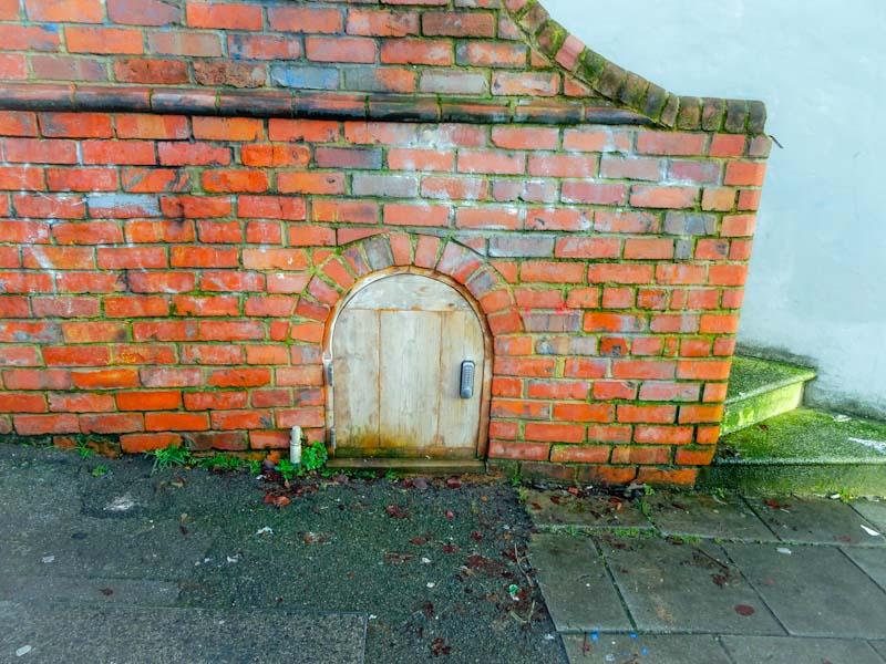 Small door to under stairs store, Bristol, December 2019