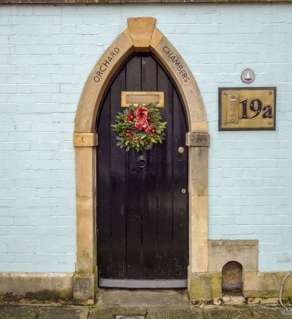 Arched garden door with a boot scraper, Bristol, December 2019