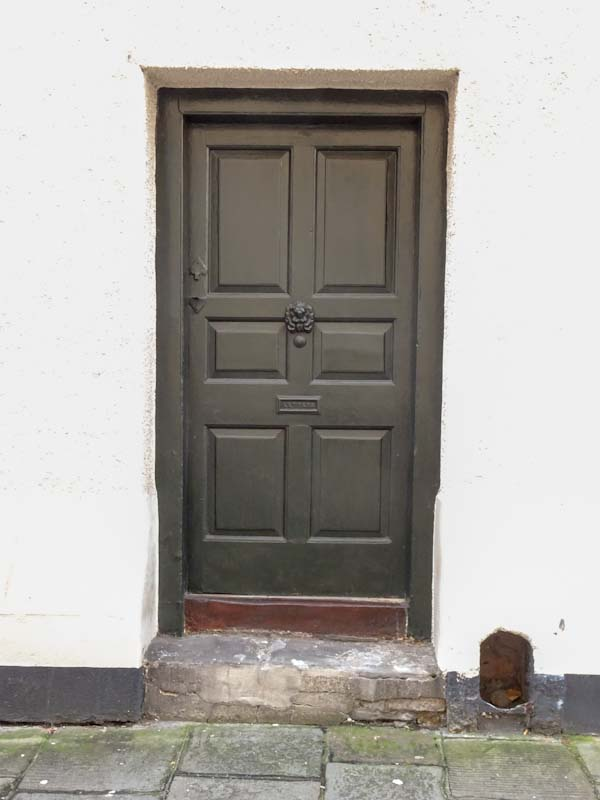 Door with a boot scraper, Bristol, December 2019