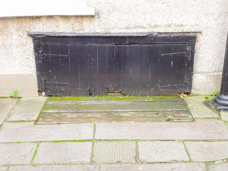 Old and probably no longer used cellar doors, Bristol, December 2019