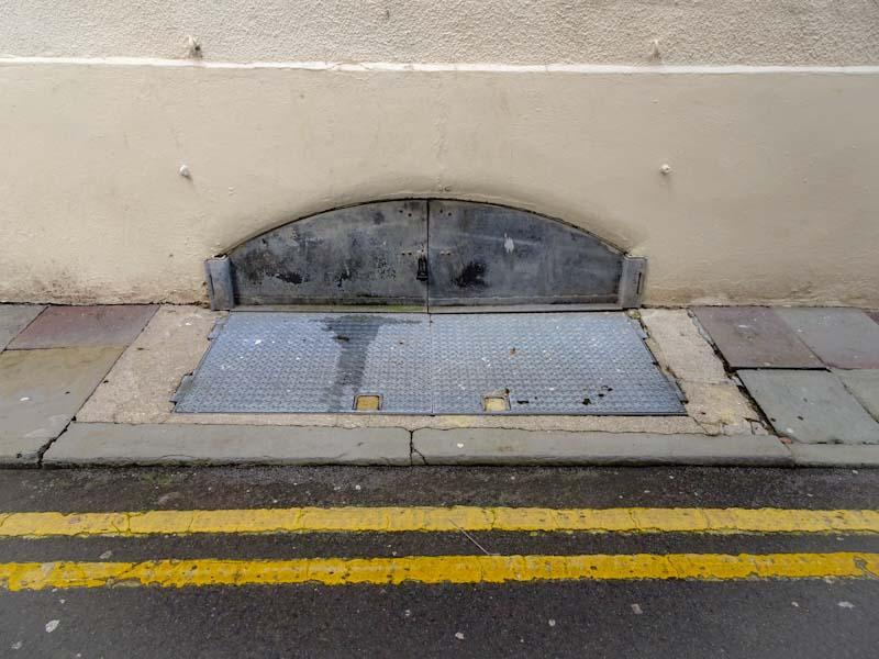 Cellar doors including pavement doors for deliveries, Bristol, December 2019