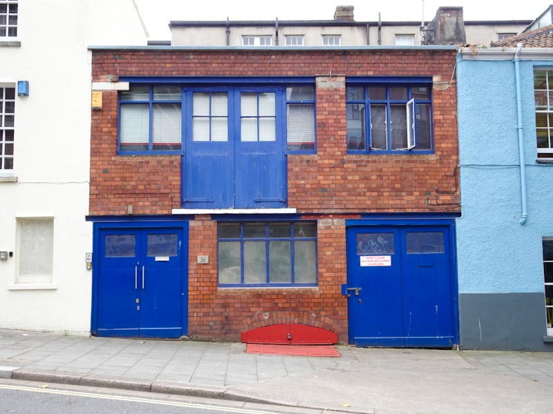 Multiple workshop doors, Frogmore Street, Bristol, July 2019