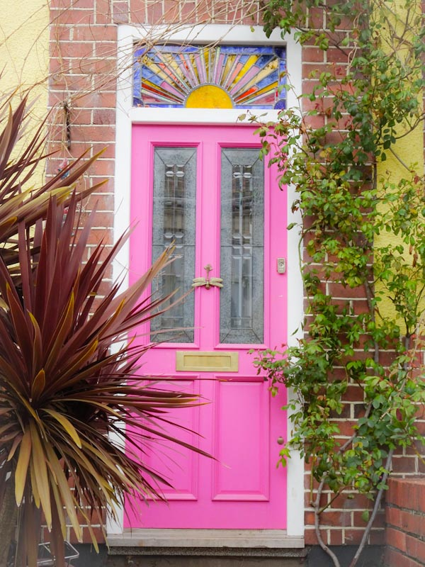Pink door with a stained glass sun, Montpelier, Bristol, March 2020