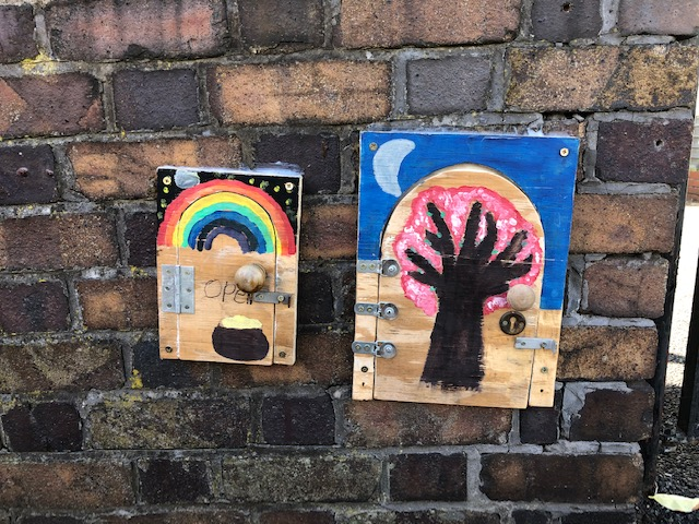 Little doors on a garden wall in Redland, Bristol, August 2020