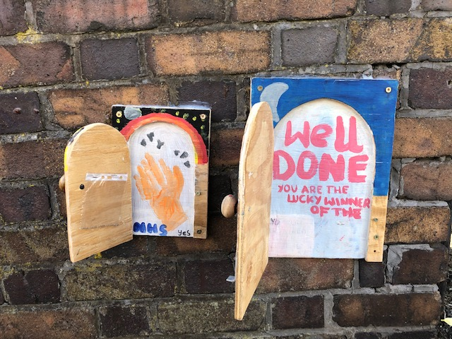 Open doors on a garden wall in Redland, Bristol, August 2020