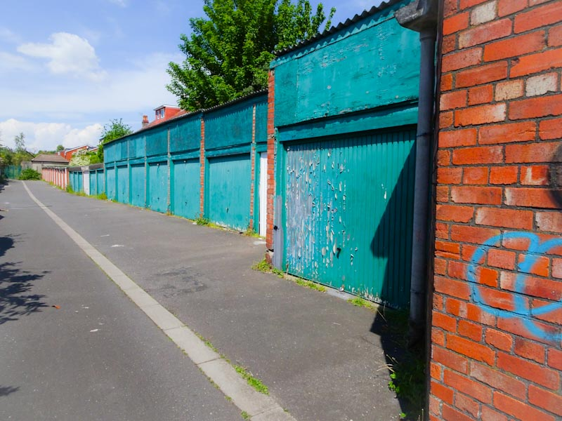 This lane is known as 'green garages' and is a safe skateboarding spot for young skaters, Redland, Bristol, May 2020