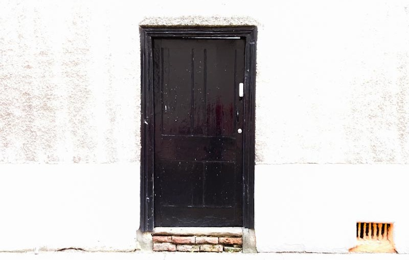 Blacl door on a bleached out background - it must have been a bright day, Bristol, October 2020