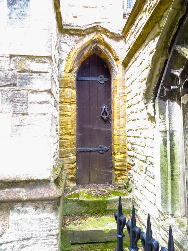 Church door for very thin people, one that hasn't been used for a while, Dorchester, June 2019