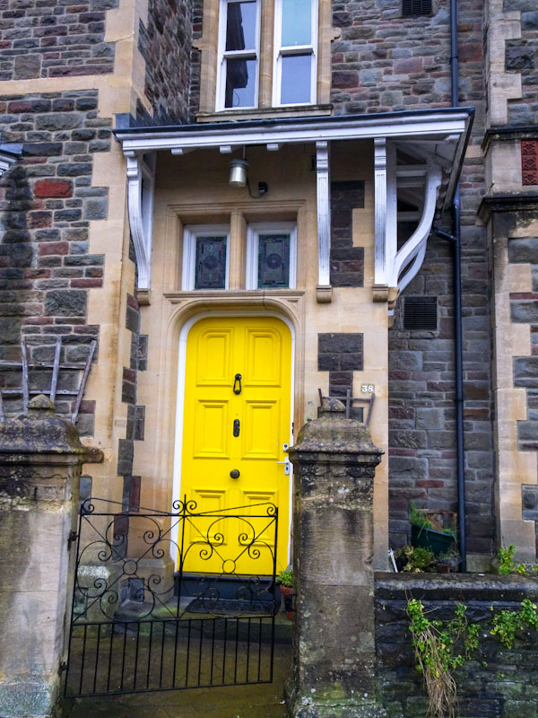 Bright yellow door with crazy awning, Redland, Bristol, December 2020