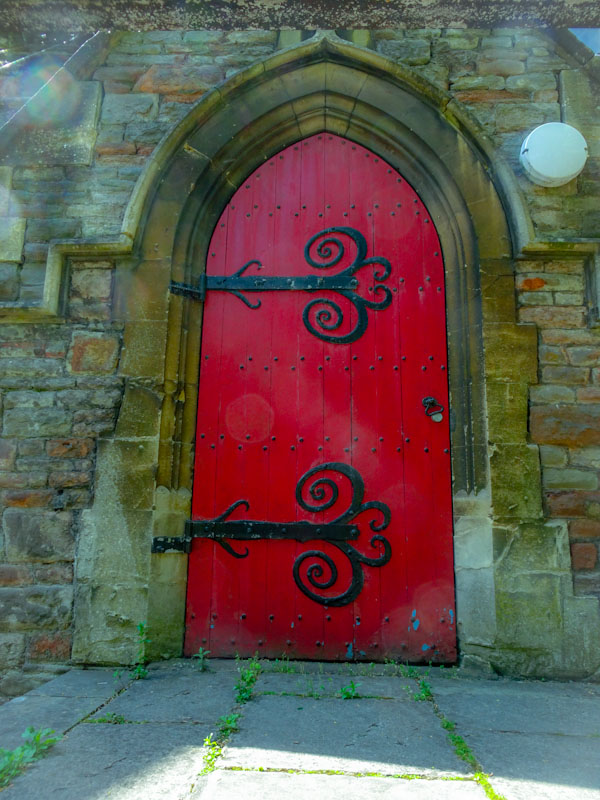Church door with (extra) large hinges, St Agnes, Bristol, May 2020