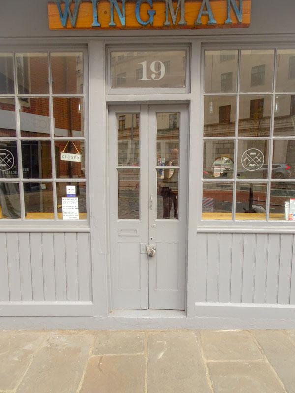 Wingman barbers door with doorfie, Christmas Steps, Bristol, June 2019