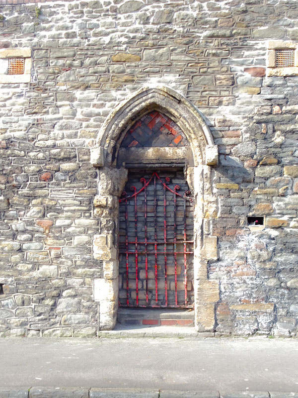 Bricked up door with the original gate intact, Bedminster, Bristol, April 2021