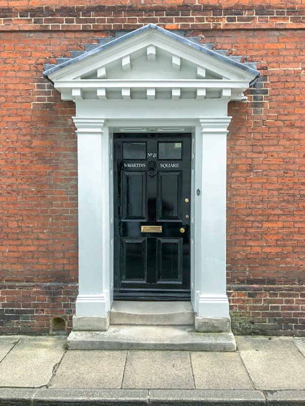 Large awning and worn steps on this door with boot scraper to the left, Chichester, May 2021