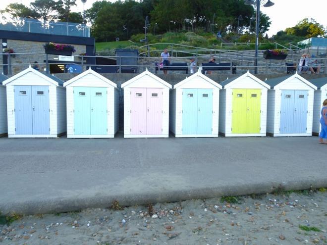 Rather sanitised beach hut doors, Lyme Regis, Dorset, July 2021