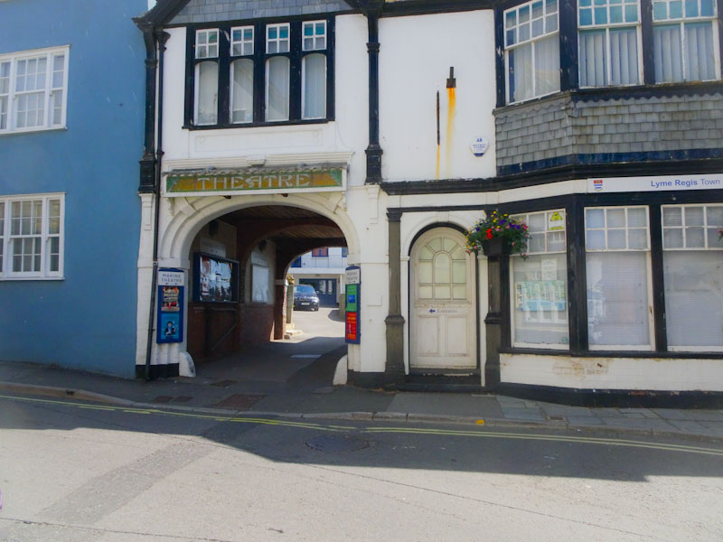 Archway to the theatre and door, Lyme Regis, Dorset, July 2021