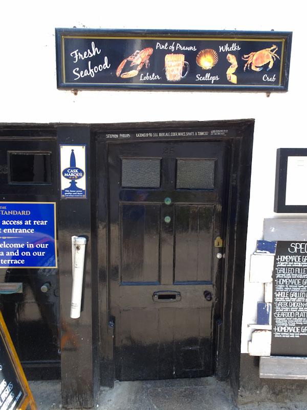 Wonky pub door, Lyme Regis, Dorset, July 2021