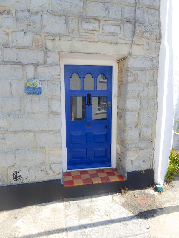 Blue door and tiled step, Lyme Regis, Dorset, July 2021