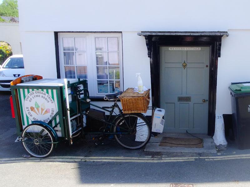 Weavers Cottage door and ice cream trike, Lyme Regis, Dorset, August 2021