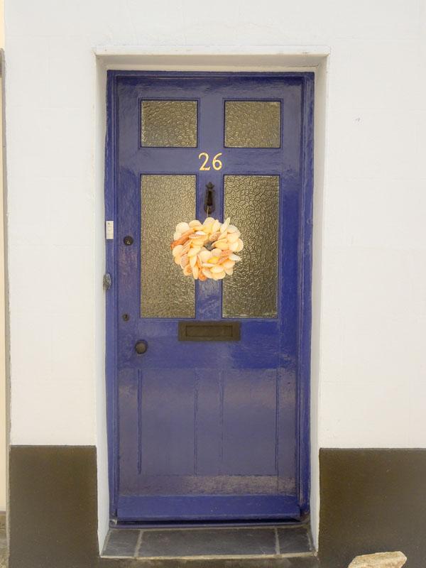 Blue door with shell wreath, Lyme Regis, Dorset, July 2021