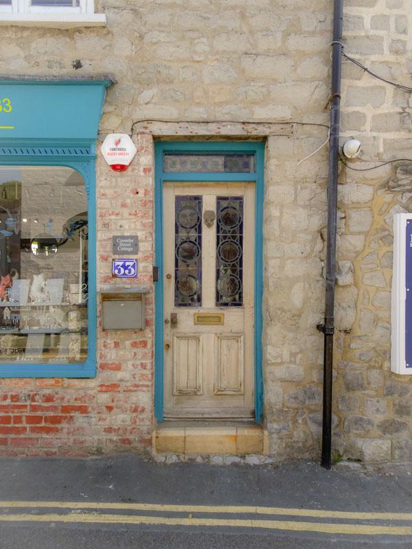 Unpainted wooden door, Lyme Regis, Dorset, August 2021