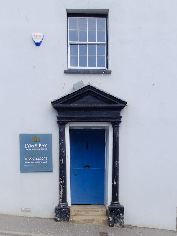 Blue door and stylish surround, Lyme Regis, Dorset, August 2021